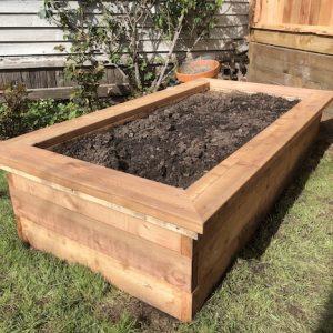 Cedar raised vegetable garden planter box with seating cap