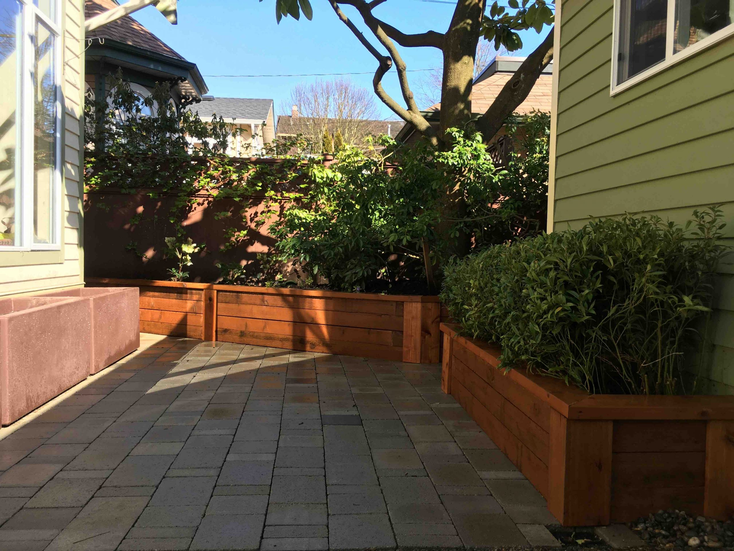 Outdoor wood dining bench integrated planter and patio
