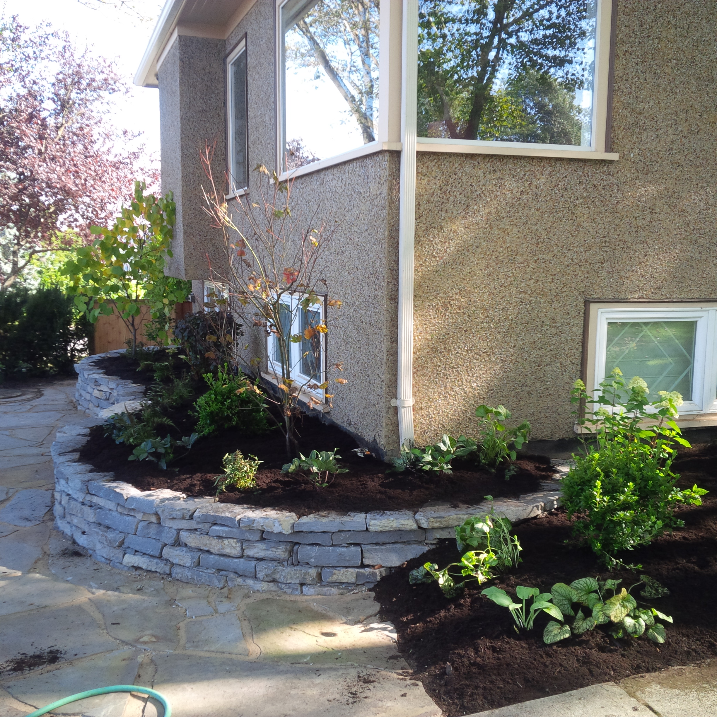 dry stone raised garden bed landscape construction vancouver bc