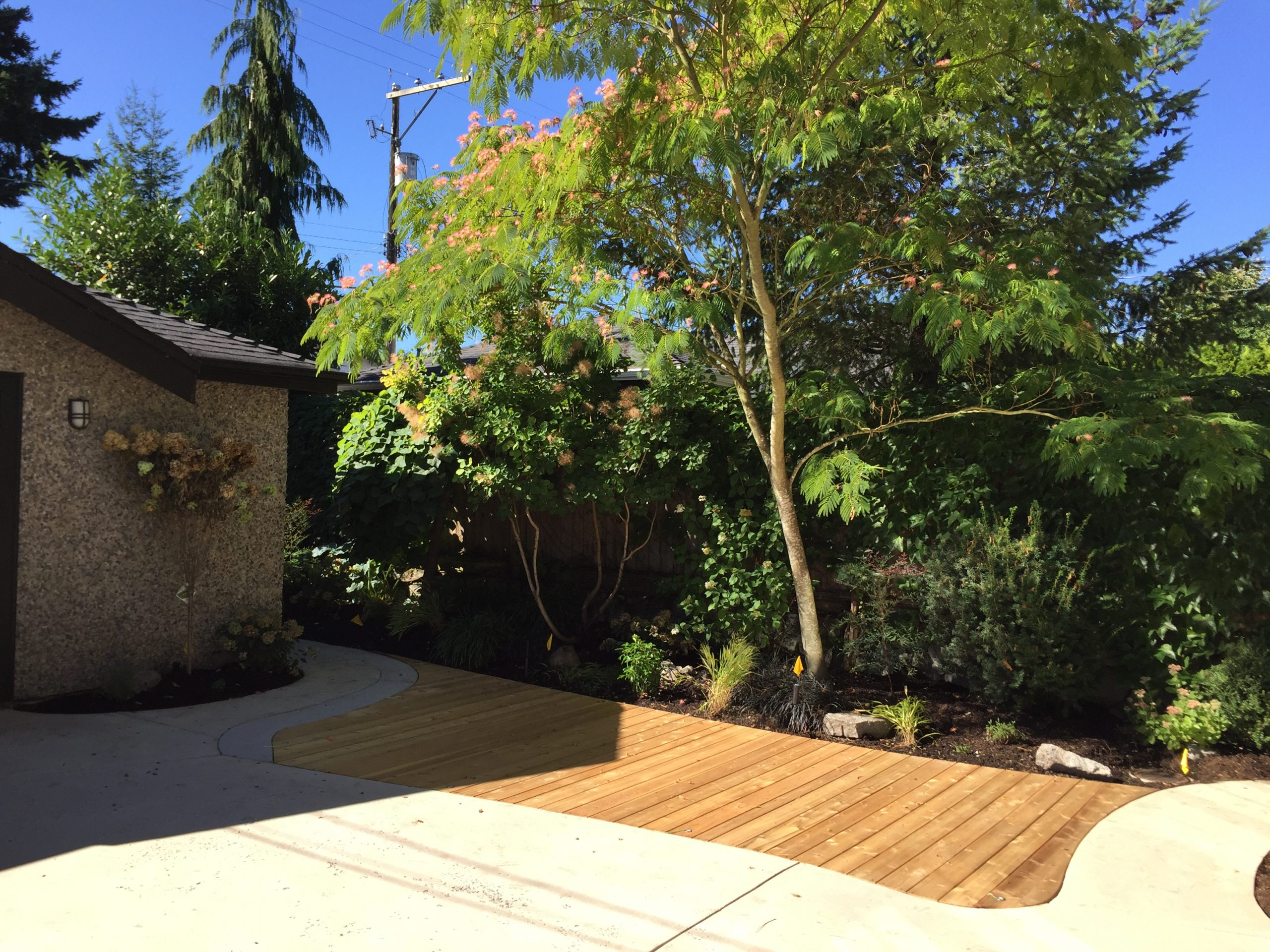 Custom cedar deck inlaid backyard landscaper vancouver bc