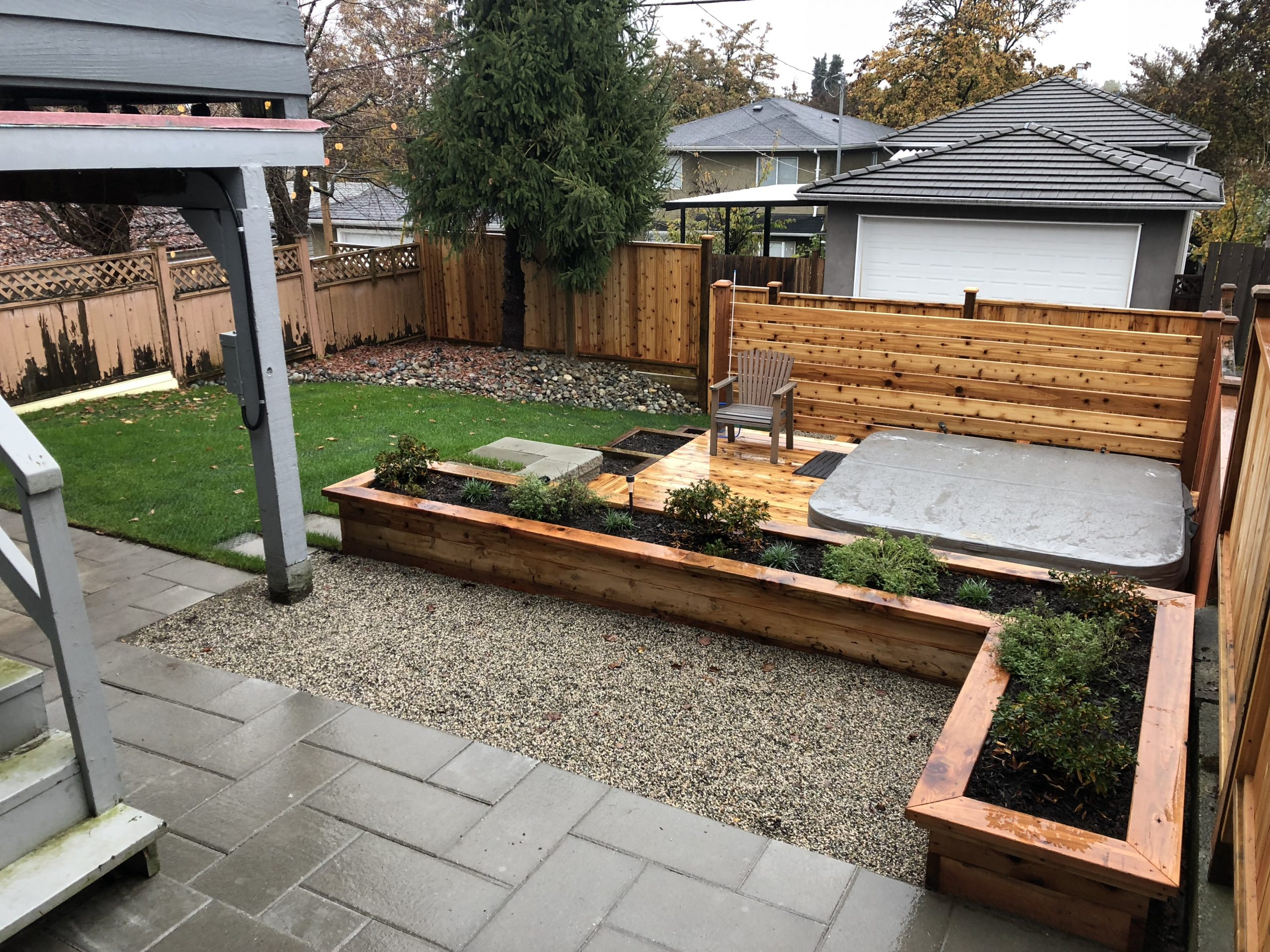 Custom cedar deck with sunken hot tub landscape construction vancouver bc garden renovation