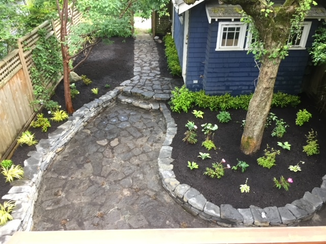 Basalt rock wall construction curved Vancouver BC landscaping